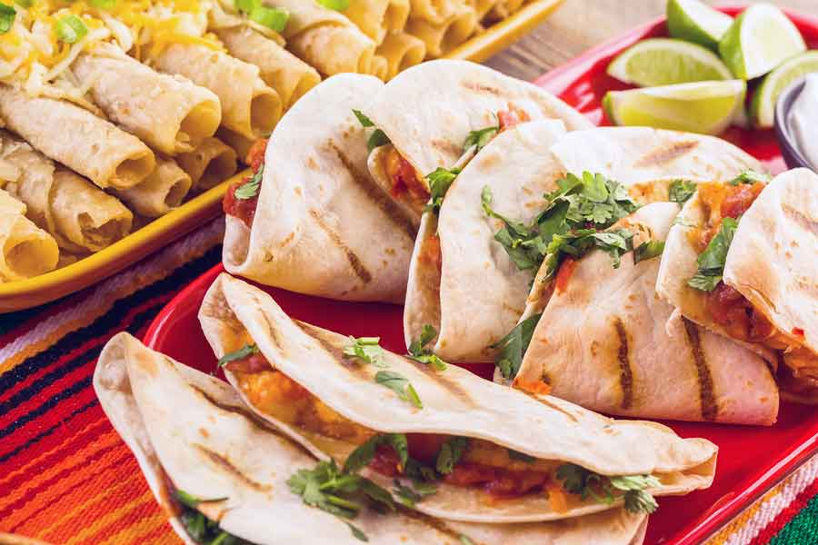 Mexican food catering is the way to go for your game day party.